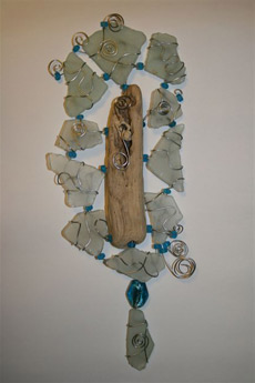Art work made from driftwood, beach collected glass and wire by Hilary Butler